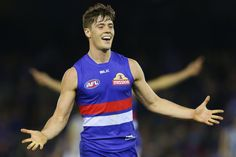 Josh Dunkley Photos Photos - Josh Dunkley of the Bulldogs celebrates a goal during the Western Bulldogs and the North Melbourne Kangaroos at Etihad Stadium on August 6, 2016 in Melbourne, Australia. - AFL Rd 20 - Western Bulldogs v North Melbourne