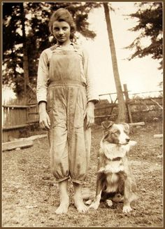 vintage farm photo of a little girl and her dog