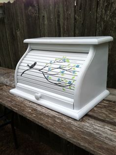 A personal favorite from my Etsy shop https://www.etsy.com/listing/204958934/white-bread-box-with-bird-sitting-on
