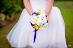 Yellow, white and vibrant blue bouquet.