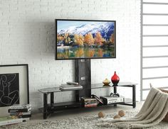 "Taijo collection large modern styled black metal TV stand with glass shelves and TV mount.  TV stand features a TV mount on the back with glass shelves.  Measures 59"" x 17"" x 54"" H.  Some assembly required."