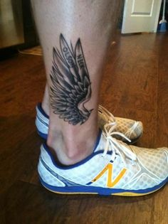 Ankle wing tattoo