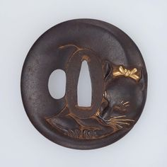 Tsuba in the form of a sleeping cat - mid to late 19th century | Museum of Fine Arts, Boston