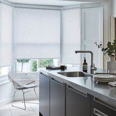 Beautiful tonal patterns add a new depth into a minimalist home, keep it monochrome with whites and greys to create a stylish modern theme. Our Spectral Stone Roller blind from our exclusive collection is perfect for this room. White Roller Blinds, Made To Measure Blinds, Kitchen Blinds, Room Themes, White Decor, Minimalist Home, Window Coverings, Beautiful Homes, House Beautiful