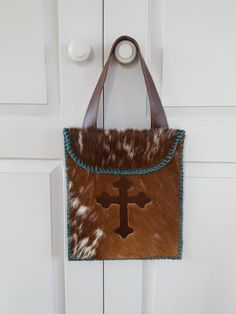 99dec41158 Items similar to Cowhide Diaper Wallet with Leather Cross on Etsy