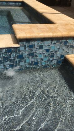npt national pool tile imperial fusion with grey grout and blue granite pebble and flagstone pavers