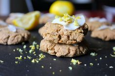 Soft & chewy melt in your mouth cookies made w/ creamy almond butter, zested w/ lemon, and topped w/ coconut. GF/paleo/vegan.
