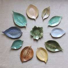 A sampling of leaves - or is it more aptly called a neatly arranged pile? Whichever - these are nearly all of the available glazes.  Swipe left for close-ups of my favorites.