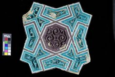 This tile fragment was originally part of a larger ornamental frieze. It decorated a magnificent domed mausoleum at Bukhara in Uzbekistan that was erected over the grave of Buyanquli Khan.