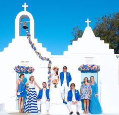 blue groomsmen blazors and blue bridesmaid dresses for a destination wedding in Mykonos, Greece - photo by Rossini Photography