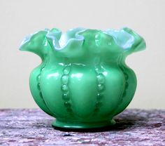 *FENTON ART GLASS ~ green milk glass vase with ruffled edge and hobnail detail.