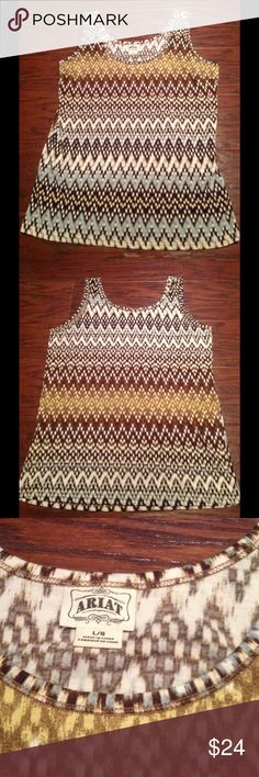 Ariat Tank Size L. Like new! Ariat Tank Size L. 95% Polyester 5% Spandex. Brown, yellow, blue, and cream. Like new! Ariat Tops Tank Tops