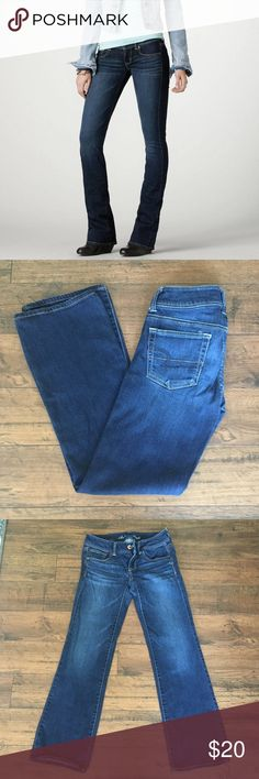"""AE Stretch Slim Boot Dark Wash Jeans American Eagle Stretch Slim Boot jeans. Color is most accurate in model photo and photo of the tag. Great condition. 76% cotton, 23% rayon, 1% spandex. 29.5"""" inseam, 7"""" rise, 14"""" waist lying flat, 8.5"""" ankle opening. Size is 4 Short. American Eagle Outfitters Jeans Boot Cut"""