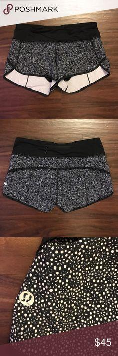 lulu lemon athletic shorts lulu lemon athletic shorts, black and light purple flower pattern, good condition lululemon athletica Shorts