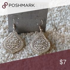 Pretty earrings. Pretty silver color earrings ready for your holiday party! Jewelry Earrings