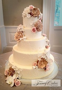 Sugar Flowers And Lace Wedding Cake, love.  Mine will only be 3 tiers,so a much smaller scale.  The small groupings of flowers match my dress