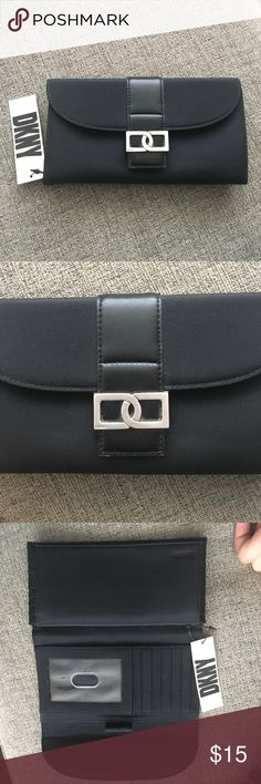 DKNY black wallet! DKNY black wallet!  This wallet has a ton of places for credit cards and has an insert for check book! This is brand new with tags never used but has been in storage. Super cute! DKNY Bags Wallets