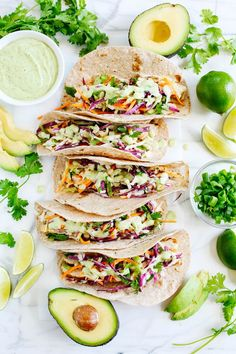 These Cilantro Lime Chicken Tacos with tangy coleslaw and avocado crema are simple, fresh and delicious making this the perfect EASY summer recipe! summer recipes Cilantro Lime Chicken Tacos - Eat Yourself Skinny Mexican Food Recipes, Dinner Recipes, Healthy Recipes, Summer Recipes For Dinner, Food Recipes Summer, Summer Meal Ideas, Slaw Recipes, Summer Dishes, Dinner Dishes