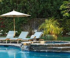 Wow! We'd love to spend a day by this pool. Tour the rest of it here: http://www.bhg.com/home-improvement/outdoor/pools-spas/backyard-pool-paradise/?socsrc=bhgpin081012poolsidepatio#page=7