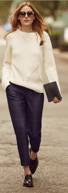 With the designed line on her sweater and the vintage plaid pants made her look extremely classic.