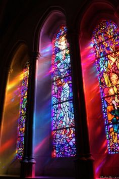 Gorgeous stained glass window with a beautiful mixture of colours. Interesting how the colours change when light is pouring through the glass