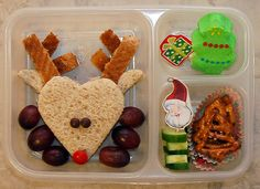 Christmas Lunch   Rudolph, the Red Nosed Reindeer   -  - Rudolph shaped sandwich with mini M&M's for the eyes & a red M&M's for his nose.      The antlers are created from the crust of the bead.  - Red-seedless grapes  - PEEPS Christmas Tree with a present cupcake pick  - Cucumber slices held together with a Santa cupcake pick & Christmas tree shaped pretzels