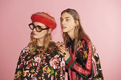 Looks from the Gucci Garden Collection, a sweatshirt featuring the capsule's flora and fauna print and lurex Web stripe cuffs. Reversible printed silk bomber jacket.