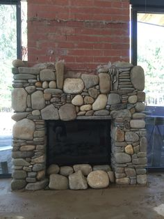 Fireplace in progress. Outdoor Stone Fireplaces, River Rock Fireplaces, Stone Masonry, Wood Stove Hearth, Stone Fireplace Designs, Cabin Fireplace, Log Cabin Homes, Hearths, House Design