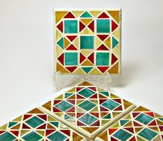 Stained glass mosaic coaster set red gold by threesisterscandles Mosaic Tray, Mosaic Glass, Stained Glass, Glass Art, Coaster Set, Red Gold, Trays, Amber, Mandala