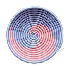 Brighten up a table or a wall with this beautiful Blue Pink Swirl Plateau. Whether you fill it with apples or hang it up as a decoration, this basket is sure to be a lovely and eye-catching addition to any room.