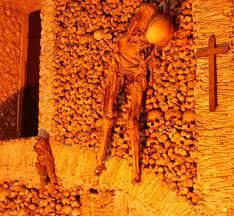 Capela dos Ossos, Evora, Portugal.  AKA the Chapel of Bones. Monks in the 16th century moved the remains of 5,000 corpses into a consecrated chapel- and like medieval Martha Stewarts, decorated the space with their bones.