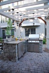 Outdoor kitchen   by momslandscaping