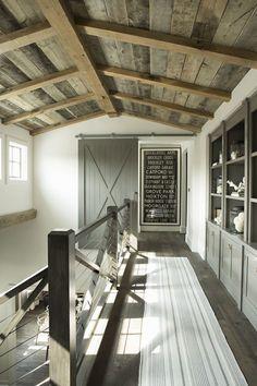 Upstairs hallway - farmhouse barnwood vaulted ceiling - staircase
