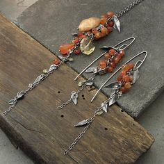 TO USE DISCOUNT, YOU NEED TO ADD TO YOUR CART PRODUCTS WITH MINIMUM PRICE OF 150$ AND USE THE COUPON150 Handmade earrings are made of oxidized silver 925 and carnelian & citrine Dimensions: The whole length: 4.1 (10.5cm) Stones: 0.08-0.2 (2-5 mm) Single earrings weight: 4 g Our offer also includes also suitable necklace to the set. Thank you for visiting