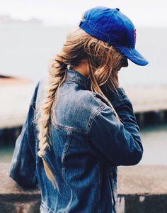 big braid, jean jacket and a baseball cap