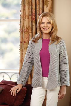 This open front knit jacket is perfect for a sparkling night out on the town. The long sleeves feature an eyelet pattern, while the open front shows off diagonal ridges and a garter stitch collar. Great for when the night winds down from all the wedding festivities.