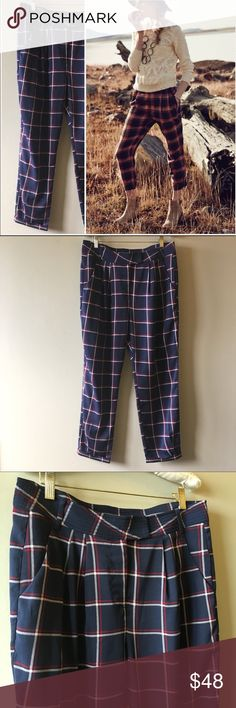 """Anthropologie navy cropped plaid pants. Like new, unworn condition. Very lightweight and silly with a fabulous drape. Navy blue with red and white plaid stripes. Tab and zipper. Cropped Pleated and cuffed hem. 32"""" waist, 12"""" rise, 25"""" inseam. Sits high on the waits. Jogger style. Pants on model are a different color but same fit. Elevenses for Anthropologie. Anthropologie Pants Ankle & Cropped"""
