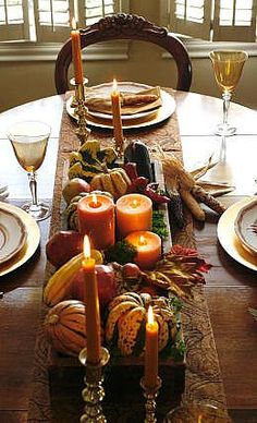 Candles, Pumpkins and Gourds on a Burlap Runner.