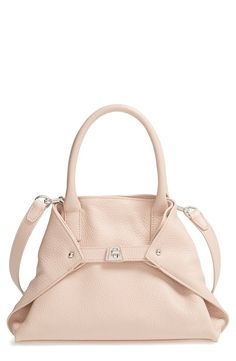 Akris 'AI Little Messenger' Cervo Leather Tote | Pale Rose | Clean, architectural lines define a modern pebbled-leather tote with a minimalist design that quickly converts for a trio of tailored looks. Carry as a classic shopper or cinch it using the inventive turn-lock tabs to create a streamlined trapezoidal silhouette. An optional, adjustable strap offers additional versatility, allowing you to seamlessly switch from handheld to crossbody style.