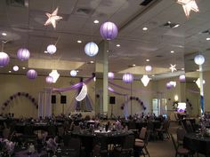 Purple Prom- The Moon and Stars theme is carried through the blue and purple hanging lanterns and silver stars with theme decor behind the DJ.  The string of pearls arches fill empty space.  The dance canopy is hung with purple tulle with a balloon center.  Maneeley's in South Windsor, CT