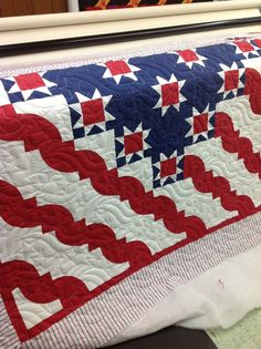 Patriotic red, white and blue Drunkard's Path quilt  - longarm quilting by Quilted Joy.  Pattern:  Stars and Stripes Quilt of Valor by Mark Lipinski at Fons and Porter