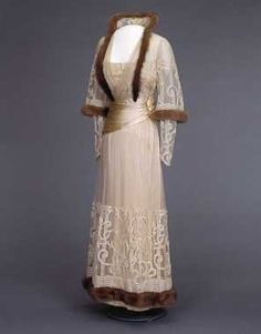 Silk satin dress with embroidered tulle overlay and fur trim, c. 1916.