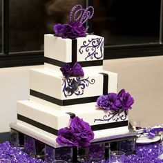 Square wedding cake with purple flowers