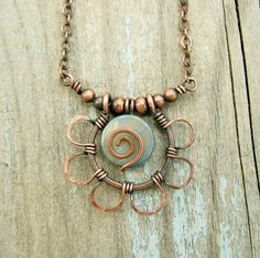 Antiqued Copper Hammered Petals with Mother of Pearl center wire wrapped by BearRunOriginals  on Etsy.