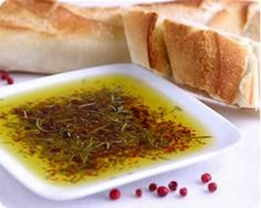 Dipping oil for bread is easy to make. Fresh minced garlic, fresh chopped basil, a sprinkle of red pepper, a pinch of kosher salt, grated parmesan cheese, covered with extra virgin olive oil.