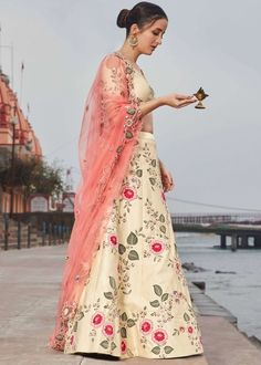 #cream #embroidery #lehenga #choli #dupatta #indianwear #traditional #outfit #beautiful #bride #new #designer #collection #ootd #wedding #time #womenswear #online #shopping Lehenga Choli Online, Silk Lehenga, Light Beige, Sequins, Satin, Yellow, Chic, Celebrities, Pink