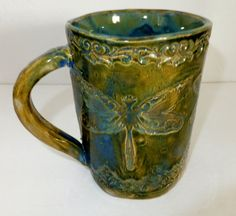 """Victorian Dragonfly Ceramic Mug Iridescent by WildCrowFarmPottery I really enjoy the results with my new """"Monet"""" looking glazes... simply beautiful!"""