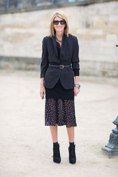 Sarah Rutson in knee length skirt, blazer with a belt and ankle boots. Paris Fashion Week, Street style.