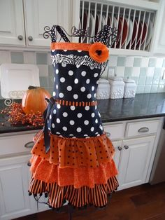 Love this apron!  Great to wear when meeting trick or treaters at the door! I wonder if there is a way to wear aprons all day long. Would that make a good fashion trend?