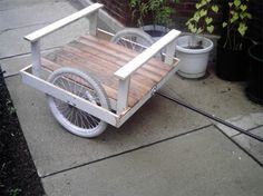 """Peter LeGrand (Chicago) makes useful bike trailers by hand out of recycled and found materials. """"I have been using things like crutches, bed frames, discarded furniture, and even a guitar to form usable, sturdy trailers for people to haul large loads."""" He salvages many of his materials from back alleys, gets others from customers and he's become quite popular at the local Salvation Army store as well. he even includes a bike hitch made of salvaged plumbing pipes with each trailer."""